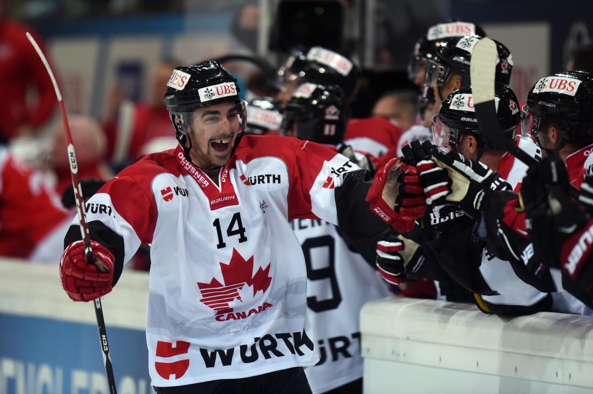 Canadas Trevor Carrick celebrate the 0:1 with the team during the game between Yekaterinburg and Team Canada at the 89th Spengler Cup ice hockey tournament in Davos, Switzerland, Saturday, December 26, 2015. (EQ Images/Melanie Duchene) MELANIE DUCHENE
